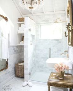 Courtney from the blog @FrenchCountryCottage incorporated her favorite elements of marble, white and vintage brassy golds to bring this charming bathroom to life. Click the link in profile to read her blog for complete project details. #lowes #bathroom #renovation