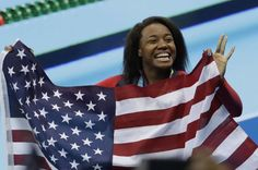 United States' Simone Manuel celebrates winning the gold medal in the women's 100-meter freestyle during the swimming competitions at the 2016 Summer Olympics, Friday, Aug. 12, 2016, in Rio de Janeiro, Brazil. (AP Photo/Natacha Pisarenko)