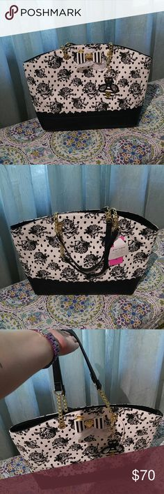 """NWT Betsey Johnson Bag in a Bag This is a NWT gorgeous black and white roses bag. Has another bag that comes with it that is yellow. Bith bags have the same black with pink roses satin like lining. Love the little bee purse ornament too! This is a big bag! Measurements are 14"""" high, 5.5"""" wide at base,  19"""" long, and handle drop is 9"""". Yellow bag is 11"""" long, 8.5"""" high, and 1.5"""" at base. Betsey Johnson Bags Shoulder Bags"""