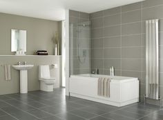 like white bath contrast with floor and wall tiles