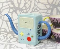 LOOK ITS BMO!!! I HEART BMO!!! AND HE IS A TEAPOT!!! BEST TEA POT EVER!!!