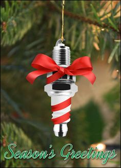 """Add a fun spark to your holidays with an auto holiday card that has a sparkplug with a bow. Size is 5x7"""""""