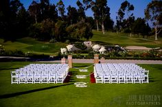 Red and white ceremony setup on the lawn at this Marbella Country Club Wedding | San Juan Capistrano, CA | Kerry Hatter Weddings and Events | Jim Kennedy Photographers