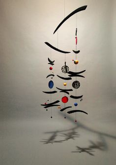 Cosmic Carnival mobile <BR/> carved wood, hand painted paper, reed, wire, 60x26x26