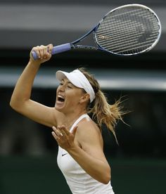 Maria Sharapova of Russia reacts after she played a return to Alison Riske of U.S. during their women's singles match on Centre Court at the...