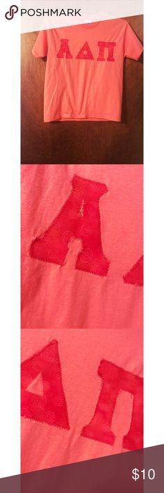 Pink Alpha Delta Pi Letters with Swirls Alpha Delta Pi Letters on Short Sleeve Hanes Heavyweight 50/50. Letters are a darker pink with white swirls and green dots. Stitching isn't the best but the shirt is perfect! Size youth large - can fit an Xsmall and likely a small well too. Cotton Blend. Feel free to ask any questions you may have! Offers welcome! Hanes Tops Tees - Short Sleeve