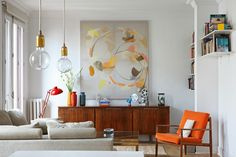 Living room canvas abstract wall art. Example of accent color matching in art with home decor. Via @homedit