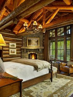 The master bedroom of this mountain cabin home has a beautiful rustic stone fireplace perfect for keeping you warm in the winter months!