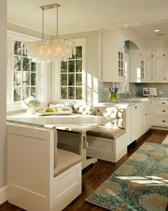 built in bench seating, light blue back drop, white cabinetry, chandelier