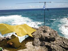 Chris W6HFP/8P9 on the eastern cliffs of the Island of Barbados working Europe/Africa with 10watts into a Mini Buddipole antenna about 60' above the salt water. QRP Ham Radio Antenna www.buddipole.com