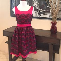 Magenta and Black Lace Sleeveless Dress Magenta and Black Lace Sleeveless Dress. Fully lined, hidden back zipper with hook-and-eye closure. Vibrant magenta dress with black lace overlay. Poly/spandex blend. Magenta fabric feels like satin. Conservative and colorful dress that's great for parties. Excellent condition. Worn only once. Size small. AKIRA Dresses