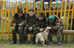 Students sit near a dog. REUTERS-Eduard Korniyenko 'Russia's kid cadets'