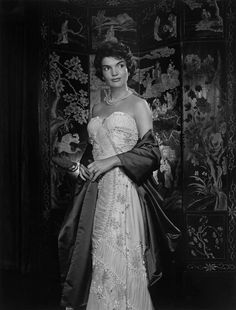 Yousuf Karsh: Jacqueline Kennedy, 1957   Widowhood and adversity had not yet touched the glamorous young wife of the handsome Senator from Massachusetts. Our meeting was at Hammersmith, her mother's home in Newport. I photographed her against a Coromandel screen that complemented her dark beauty. Weeks later, in New York, she saw me walking down Fifth Avenue and rushed toward me to inquire breathlessly about her photographs.