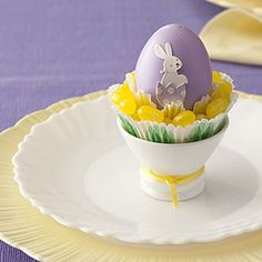 Spotlight an Egg    Use a scrapbook-embellishment bunny to decorate a dyed egg. Place a cupcake liner in an eggcup and fill with jelly beans. Nestle the egg into the candy. Your guests are sure to smile.