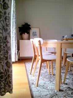 Combination of Eames chairs with Bjursta table from IKEA For