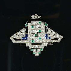 BLACK STARR FROST Watch/brooch. An art deco gem-set and diamond lapel watch, circa 1925. (hva)