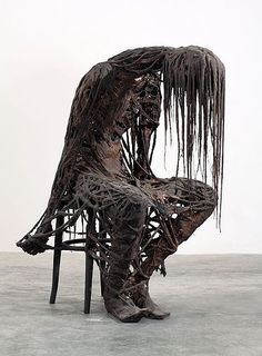 creepy sculpture This sculpture is very demented. The long black hair makes gives an impression that it has been rained on. The figure has obviously had a bad day. It dark.