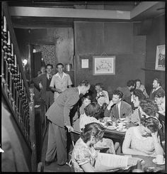 Lincoln Coffee Lounge & Cafe, Rowe Street, Sydney.    The Lincoln Coffee Lounge was a popular meeting place for Sydney bohemians & libertarians.      Find more detailed information about this photographic collection: http://acms.sl.nsw.gov.au/item/itemDetailPaged.aspx?itemID=111528      From the collection of the State Library of New South Wales: http://www.sl.nsw.gov.au