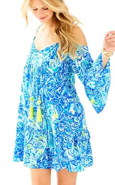 The Alana Dress is a flowy dress with bell sleeves. This boho printed dress has rope tie tassels and sunny shoulder details. We love this dress for vacations and fun days spent in the sun.