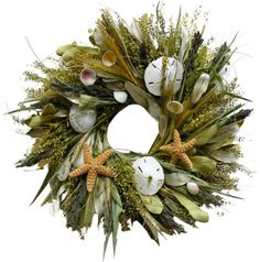 Seashell Wreath Wreath @Nicole Piatt @Rebecca Batson these could be great bridal shower decorations (turn them flat, stick a hurricane glass & candle in the middle) then upcycle them back to door wreaths for your mom & your own homes!