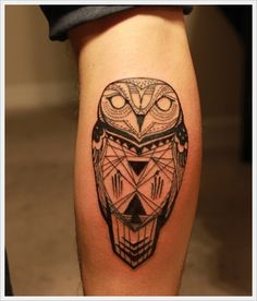 Geometric owl arm tattoo