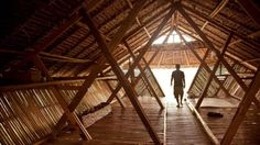 A Thai school has built four low-impact temporary bamboo dormitories designed to house refugee children from bordering Burma.