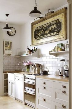 Kitchen , Farmhouse Kitchen Ideas : Farmhouse Kitchen Ideas With Large Framed Wall Quote Art With Clock And Pendant Lamps And Open Shelves And White Cabinet With Solid Wood Countertop