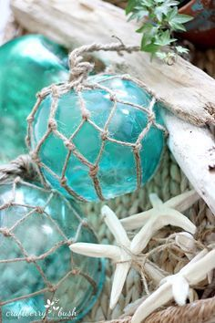 Well if you are looking for a touch of Summer…a cool Ocean Breeze…a bit of the Sea Shore…you have to hop on over to Craftberry Bush where Lucy will show you how she made her amazingly beautiful Large Glass Buoys…the DIY is quick…simple…budget friendly and gorgeous!  You are going to love these to decorate with…add …