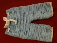 "Crochet baby boy trousers, to fit newborn. Approx. 11.5"" in length.  £10"