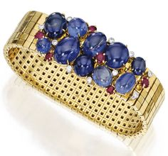Aletto Brothers - 18 Karat Gold, Platinum, Sapphire, Ruby and Diamond Bracelet - The flexible gold strap set at the clasp with ten cabochon sapphires, accented by round diamonds weighing approximately .40 carat, further set with round rubies, gross weight approximately 58 dwts, length 7 inches, signed Aletto Bros.