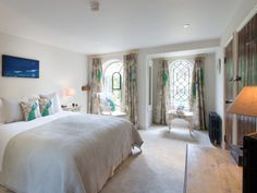 Croome bedroom, with magnificent silk curtains, at The Malt House, luxury bed and breakfast in the Cotswolds