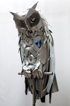 Horned Owl sculpture by Ptolemy Elrington upcycled from car hubcaps