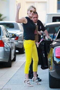 Not so mellow yellow! Sharon Stone, 57, stands out from the crowd while shopping in Beverl...