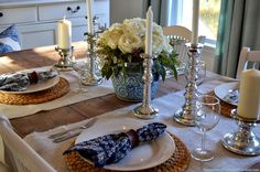 white painted wood chargers | Silver Candlesticks, wicker chargers, wine glasses: Ikea