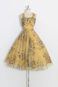 ➳ vintage 1950s dress * beautiful golden yellow floral chiffon * acetate lining * bodice with stays * unique circle halter neck piece * full skirt * metal back zipper condition | excellent fits like medium length 48 bodice 16 bust 38-39 waist 28-29 some clothes may be clipped on dress form to show best fit for appropriate size. ➳ shop http://www.etsy.com/shop/millstreetvintage?ref=si_shop ➳ shop policies http://www.etsy.com/shop/millstreetv...