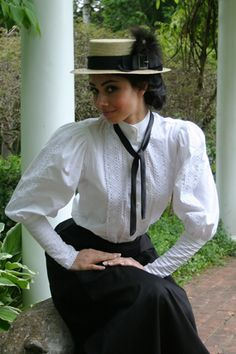 Price: $79.95  For any woman desiring a classic appearance, this Victorian styled blouse is the answer! This alluring blouse has a high collar and full sleeves. There are rows of tiny pintucking on the lower sleeves of the blouse. Lovely cotton cluny lace adorns the sleeves and the front of the blouse. Blouse has front button closure. Available in sizes XS to XXXXL. Your choice of color: white or natural.