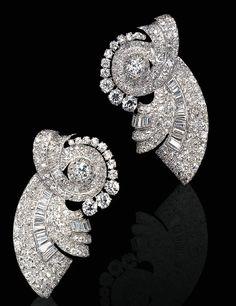 A PAIR OF ART DECO DIAMOND DOUBLE CLIP BROOCHES   Each pavé-set diamond scroll clip enhanced by old European and baguette-cut diamonds, mounted in platinum, circa 1935