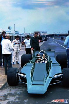 Carlos Reuteman testing Lotus 80 Silverstone 1979.  Andretti watches with interest.