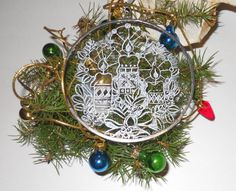 Such intricate carving!  Lovely.  Etsy seller artophile.  http://www.etsy.com/listing/115381902/hand-engraved-christmas-tree-ornament  Hand-Engraved Christmas Tree Ornament. $10.00, via Etsy.
