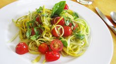 Zucchini pasta with basil and cherry tomatoes.