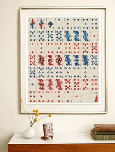 Framing a deck of cards is a cool art idea.  This might be interesting to try with an old deck of tarot cards.