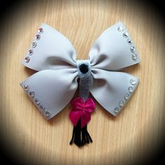 Eeyore Style Hair Bow.  Grey Grosgrain Ribbon Decorated with White Crystals and Eeyore Tail Centrepiece.  Mounted on an alligator clip.  I can do custom bows, just let me know if youd like something specific.  Price is for single bow.