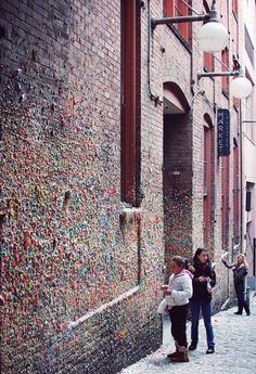 Stick your gum on the Market Theater Gum Wall, a local landmark in downtown Seattle, in Post Alley under Pike Place Market. Similar to Bubblegum Alley in San Luis Obispo, California, the Market Theater Gum Wall is a brick alleyway wall now covered in used chewing gum. Parts of the wall are covered several inches thick, 15 feet high for 50 feet   Needa do this next time.