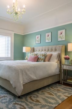 Lovely feminine bedroom with various shades of green and pink giving the space a relaxing and soothing feel.