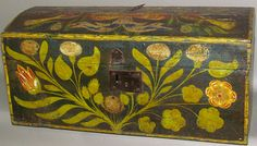 """Horst Auctions 2/11/17 lot 551 (front view). Est: $300 - 600. Realized: $2,100.   Description: ca. 1800-1820; softwood dome top rectangular chest in polychrome blue paint with bold flower on sides & front & birds with tulips & banner on lid. Wire hinges & a partial lock, 25""""x 13""""x 11 3/4"""". Condition Report: Missing original hardware handles; Partial decoration of lid is missing; Lid has some splits; Base has substantial bug damage toward hinge side."""