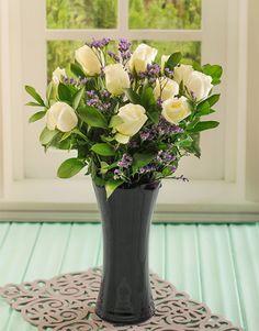 White Roses in a Black Glass Vase