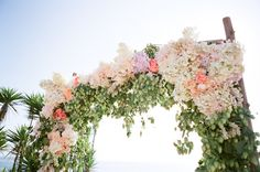 stunning floral ceremony altar  Photography by picotteweddings.com, Floral Design by flowerwild.com