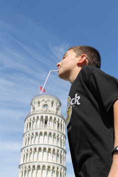 Thirsty: Drinking from the world famous Leaning Tower Of PISA