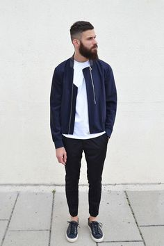 Consider teaming a dark blue bomber jacket with black chinos for a Sunday lunch with friends. Dress down this getup with dark blue low top sneakers.   Shop this look on Lookastic: https://lookastic.com/men/looks/navy-bomber-jacket-white-crew-neck-t-shirt-black-chinos/16939   — White Crew-neck T-shirt  — Navy Bomber Jacket  — Black Chinos  — Navy Low Top Sneakers