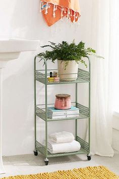 Turn that useless square foot of bathroom corner into three shelves for your towels, candle, + thriving fern!